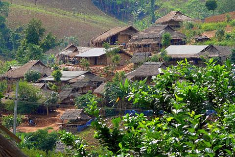 Akha Hill Tribe Village In Thailand by Butch O.