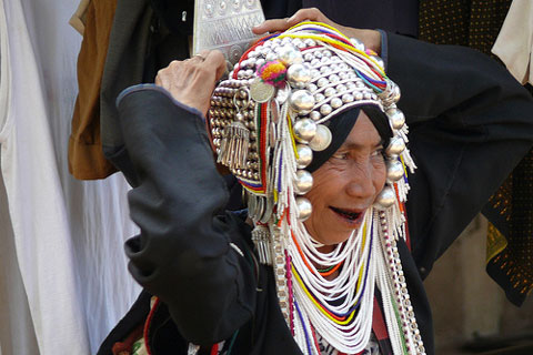 Colorfull Headress of The Akha Hill Tribe In Thailand photo by Butch O