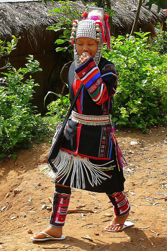 Young Girl Of The Akha Hill Tribe In Thailand photo by Butch O