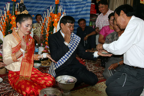 the thai movie laos wedding A traditional laos wedding is usually held at the bride's family home which involves a baci ceremony followed by reception party in late morning or evening.