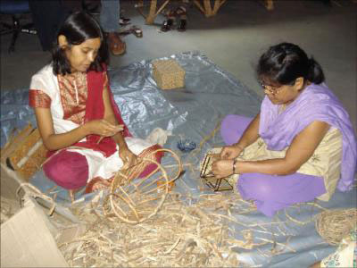 Entrepreneurs producing handicrafts from water hyacinth at a training programme organised by NEDFi